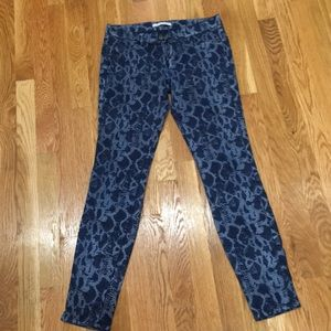 Snakeskin print jeans.